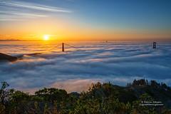 Golden Gate Sunrise (Darvin Atkeson) Tags: ocean sanfrancisco california city morning bridge fog sunrise landscape dawn coast glow pacific towers foggy coastal goldengatebridge goldengate diablo darvin hawkhill breakingdawn atkeson darv liquidmoonlightcom lynneal