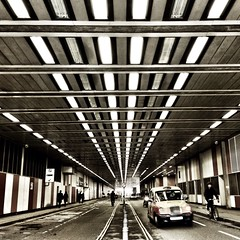 Tunnel traffic (Rob Emes) Tags: city london square lights taxi perspective tunnel barbican faded 365 iphone barbicancentre 365project iphone5 iphoneography 3652013 uploaded:by=flickrmobile flickriosapp:filter=nofilter mar2013