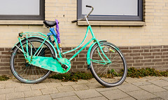Old bike (RuudMorijn-NL) Tags: breda noordbrabant aqua bakstenen blauwe damesfiets fiets gaar gare gebouw gemetselde geparkeerd gestald geverfd groen ketting kettingslot kleur kleurrijk lichtgroen muur opvallend oud oude paarse pand preventie rijwiel slot stoep straat straatbeeld trottoir vervoermiddel green bicycle bright bike summer retro lifestyle vintage travel city colored outdoor color wall old street town frame rusty cycle stone classic grunge female scene style fixed urban nostalgia weathered netherlands dutch facade brick