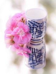 In the mirror ~ Macro Mondays (Ani Carrington) Tags: macromondays inthemirror geranium stilllife small vase blue white soft