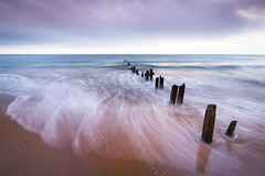 Sandsend in Pastel (swoosh) (aveyardphotography) Tags: high tide receeding groynes soft pastel colour color wooden nature seascape waves wash ripples cloudy sky seaweed smooth clean blue orange andy aveyard serene calm calming swirling water beach