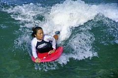 Boogie-Boarding (1) (AntyDiluvian) Tags: hawaii 2001 30thanniversary oahu honolulu waikiki waves surf boogieboard boogieboarding girl woman