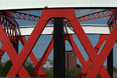 Red and White bridge at Manchester (Tony Worrall) Tags: england northern uk update place location north visit area county attraction open stream tour country welovethenorth northwest unitedkingdom gmr manchester manc city metal painted bridge iron supports salford crossing beams pattern lines shapes images red white bars support