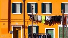 Orange Burano (Mario De Leo) Tags: venice italy orange detalle detail canon island rebel italia clothes venecia isla ropa burano anaranjado 550d t2i mariodeleo accrama