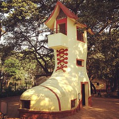 The boot at the Hanging Garden - Mumbai (ToGa Wanderings) Tags: park india house home fairytale garden square boot culture squareformat bombay hanging rise mumbai iphoneography instagramapp uploaded:by=instagram foursquare:venue=4b0587d1f964a520e2a222e3