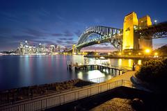 Sydney shine (Luke Tscharke) Tags: bridge reflection water ferry night skyscraper geotagged pier arch sydney australia walkway wharf coathanger cbd cliche sydneyharbourbridge kirribilli milsonspoint portjackson jeffreysst geo:lat=3384970603483921 geo:lon=1512143450975418