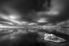 Frozen lake (Matthias Lehnecke | www.ml-foto.se) Tags: longexposure sea bw lake snow seascape cold ice beach clouds contrast reflections movement rocks stones shoreline dramatic formation