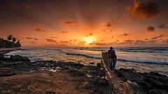 Chasing The Sun (GOJR.) Tags: ocean sunset red orange sun seascape beach nature water colors clouds landscape island sand nikon puertorico sigma wideangle playa aguadilla borinquen seacscape nikond40 sigma816mm