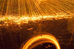 2012-10-18 RVG_8877 Sparkling reflections (ralphvandergeestfotografie) Tags: orange lightpainting water tripod creative spinning sparks afterdark longexposuretime steelwool movementandmotion nikond300 ralphvandergeestfotografie ralp0hvandergeest