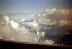 33-607 (ndpa / s. lundeen, archivist) Tags: nick dewolf nickdewolf 33 reel33 color photographbynickdewolf 1970s 1972 fall film 35mm winter 1973 aerial fromtheair fromtheairplanewindow hawaii honolulu oahu clouds