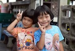 cute girls sending you peace (the foreign photographer - ) Tags: aug142016nikon two cute girls children peace signs khlong thanon portraits bangkhen bangkok thailand nikon d3200