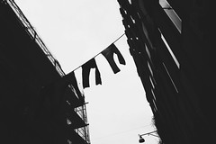 (jean_pichot1) Tags: windows pants up high lamp scaffolding contrast sky dark silhouette buildings narrow gothenburg street above across line hanging jeans