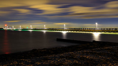 Guiding Light (djryan78) Tags: night victoria sand winter sigma pier australia outdoor canon longexposure 24105 clouds smooth 6d rosebud beach reflection portphillip sigma24105 cloud dslr canon6d cold light portphillipbay bay melbourne water