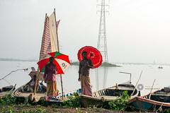 Boatmen are waiting for visitors (Manzur Ahmed) Tags: beribandh mirpur dhaka bangladesh haor waterlogged umbrella red boat wooden outdoor august 2016 nikon d7100 nature