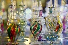 Perfumed (Sanjiban2011) Tags: doha qatar perfume perfumebottle objects artisticobjects bokeh depthoffield arrangements tabletop nikon d750 fullframe fx nikon24120 indoor colours bottle
