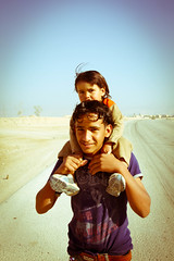 Siblings (Daria Angeli) Tags: road winter boy people december faces middleeast expressions streetphotography siblings jordan littlegirl 2012 flickraward