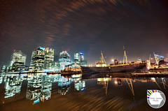 Boatside Docklands (Think James Photo) Tags: blue reflection london water glass thames architecture night river boat office dock railway wharf docklands block canarywharf hdr highdynamicrange hdri docklandslightrailway