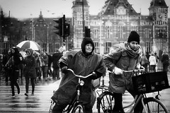 The rain comes through my jacket... (Vicktor Abrahams) Tags: street city people holland rain amsterdam bike canon walking 50mm iso100 flickr dof bokeh walk candid streetphotography rainy netherland streetphoto cinematographer cinematic 1320 vicktor 600d blackwhitephotos bokehlicious 18