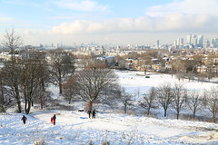 Snowy Greenwich with Canary Wharf and the City behind (Uretopia) Tags: park city snow london greenwich wharf canary sled shard oldroyalnavalcollege