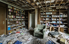 The reader (Explore) (odin's_raven) Tags: light urban house abandoned photography chair nikon waiting europe decay library room exploring explorer ghost books spooky urbanexploration mission manor doctors exploration raven hdr highdynamicrange decayed urbanexploring ue urbex photomatix nikor odins d700 1424mm talkurbex odinsraven odinsravenphotography