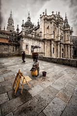 Behind the Cathedral (Photos On The Road) Tags: church rain vertical outside outdoors spain chair europa europe photographer cathedral outdoor chiesa galicia santiagodecompostela baroque umbrellas pioggia sedia barocco spagna fotografo verticale cattedrale outdoorshots galizia ombrelli outdoorshot flickrsfinestimages1 flickrsfinestimages2 bestevercompetitiongroup