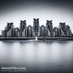 The Invaders [EXPLORED] (Aaron Yeoman) Tags: city uk longexposure greatbritain travel england urban blackandwhite bw motion reflection building london art water architecture reflections pier boat blackwhite movement europe apartments quiet unitedkingdom empty jetty transport smooth line transportation slowshutter gb vignetting vignette thamesriver a77 thethames watertransport stgeorgeswharf neutraldensity graduatedfilter nd110 residentialapartments sigma1020mm1456exdchsm sonya77 lee09ndgrad leebigstopper slta77 sonyalphaslta77