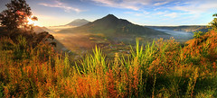 THE PANORAMA of BATUR CALDERA (ManButur PHOTOGRAPHY) Tags: morning travel sky bali panorama sun mist mountain green nature beautiful grass fog sunrise canon indonesia landscape photography eos volcano three nationalpark google scenery asia exposure village view pano explorer hill natur grain vivid east explore filter caldera 7d usm tradition dslr filters efs 1022mm hitech rol batur tonal contras treking threes mountainscape eastasia canonefs1022mmf3545usm fogy hikking f3545 beautifulbali canon7d easasia manbutur manbuturphotography