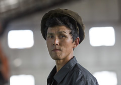 Worker Man At Hungnam Fertiliser Complex, Hamhung, North Korea (Eric Lafforgue) Tags: portrait color colour men industry horizontal asian women war asia factory working womanonly visit korea indoors cap worker asie coree oneperson northkorea chemical onepeople redstar headandshoulders occupation industrialarea d