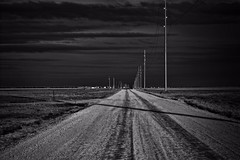 Back Road (Chains of Pace) Tags: road blackandwhite storm oklahoma clouds country western dirtroad guymon goodwell
