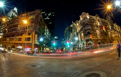 Sixth and Brazos (Tom Haymes) Tags: trafficlights night austin lights texas fisheye timeexposure austintexas carlights sixthstreet austinsixthstreet driskillhotel