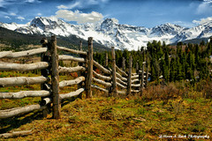 Beyond The Fence (Aspenbreeze) Tags: road mountain snow rural fence country hills pasture peaks sanjuanmountains splitrailfence snowypeaks logfence moutainscape aspenbreeze moonandbackphotography gpsetest bevzuerlein roughwoodfence