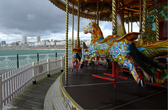 Brighton Pier Carousel and skyline (oxfordian.world) Tags: greatbritain england amusement seaside brighton carousel brightonbeach brightonpier gradeii oxfordian 201209 lumixlx7 oxfordianworld oxfordiankissuth thebrightonmarinepalaceandpier