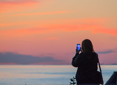 Photographing the Sunset (Infomastern) Tags: goodnightsunset malm vstrahamnen hav mobil people phone photographing pictureinpicture sea solnedgng sunset woman exif:model=canoneos760d geocountry camera:make=canon geocity camera:model=canoneos760d geostate exif:isospeed=3200 geolocation exif:lens=efs18200mmf3556is exif:aperture=56 exif:focallength=200mm exif:make=canon
