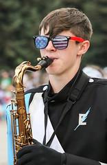 Patriotic Sax Player (wyojones) Tags: wyoming cody codystampederodeo codystampederodeoparade parade 4thofjuly easthighschool thunderbirdmarchingband cheyenne sax saxophone shades sunglasses patriotic marchingband boy guy man horn wyojones