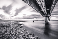 Under the pier (chrocoflo) Tags: sony alpha emount a7 ilce7 ilce7m2 available light beach waves seascape landscape zingst seebrcke berlin germany europe manual black white bw monocrome samyang 14mm