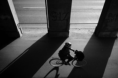Appreciated light (Bjarne Erick) Tags: girl bike bicycle harshlight contrast street blackwhite blackandwhite bw noirblanc monochrome 19mm 28mm wcl