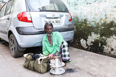 The Man Who Renounced The World is Living in the Car Parking (Mayank Austen Soofi) Tags: delhi walal sufi the man who renounced world is living car parking