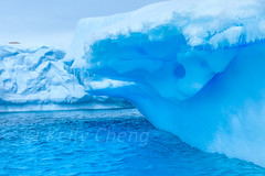 Antarctica-111123-572 (Kelly Cheng) Tags: travel blue white mountain color colour tourism nature water sunshine horizontal clouds landscape island daylight colorful day cloudy outdoor vivid sunny antarctica nobody nopeople iceberg colourful traveldestinations cuvervilleisland antarcticpeninsula