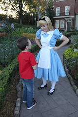 Talking With Alice (Sam Howzit) Tags: uk epcot character disney characters waltdisneyworld aliceinwonderland athan worldshowcase unitedkingdompavilion