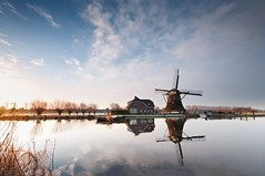 Silent Lucidity (martijnvdnat) Tags: winter light sky reflection mill water netherlands windmill weather clouds sunrise river landscape dawn landscapes leiden nikon frost day thenetherlands farmland dyke polder molen windpower warmond landscapephotography d90 broekpolder sigma1020 zijl skylovers cmartijnvdnat