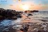 sunset (Ahmed Turki) Tags: blue winter light sunset sea sky sun seascape beach water sunrise canon landscape eos rebel bahrain rocks wintersunset natur t3i topshots mywinners theunforgettablepictures efs1855mmis canon600d ahmedturki 890904162