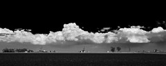 Spring Storm Building (Tom Herlyck) Tags: clouds blackwhite spring colorado farm pueblo