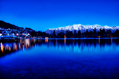 Queenstowns Blue Mountains - New Zealand at the Blue Hour (Sprengben [why not get a friend]) Tags: morning travel newzealand summer sky urban sun mountains fog clouds skyscraper forest island coast rocks sheep pacific time flock meadow symmetry metropolis tasmansea peterjackson linear thehobbit mountcook abeltasmannationalpark travelphotography farewellspit d700