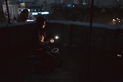 Kinki (HIKARU Pan) Tags: light portrait woman rooftop girl bike bicycle night toy outdoors photography asia sitting fireworks chinese chinesenewyear youngwoman china1 35l canonef35mmf14lusm 5d2