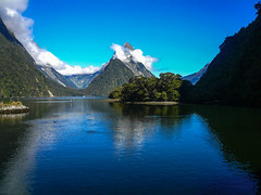 Milford-Sound (FarbenfroheWunderwelt) Tags: blue newzealand sky mountains nature water beautiful forest nice cloudy natur journey traveling alpen neuseeland