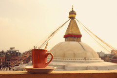 View of the Boudhanath Stupa with a morning cup of cappuccino - (cococinema) Tags: life city morning travel nepal light orange color tourism cup coffee yellow landscape asian photography photo nice asia day peace tour view time tea outdoor stupa capital religion dream happiness tourist fresh best kathmandu times guest dear cappuccino goodmood boudhanath buddism mage pilgrimage mecca religous nepali bouda coloful cococinemacom cococinema prekrany piaceful