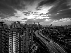 darkness.. (TOREX PHOTOGRAPHY) Tags: longexposure sunset sky bw clouds buildings dark mono landscapes blackwhite nikon cityscape slowshutter kualalumpur klcc kltower hoya nd400 d90 petronastwintower sigmalenses hitamputih torex jelatek berembang torexphotography