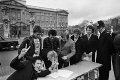 Sex Pistols Signing With A&M (MrScroobs) Tags: uk england people musician music men london english westminster writing table outfit clothing gate uniform suits europe punk looking furniture coat watching group helmet gesturing band tshirt palace shirts jacket buckinghampalace document males prominentpersons singers bassist drummer british whites contract musicalgroup peacesign adults rockband punkband blazer signing guitarist leatherjacket bending europeans businessmen businesspeople dwelling sidvicious headgear percussionist johnlydon policeofficer stevejones casualclothing westerneuropeans innerlondon outerwear legaldocument thesexpistols paulcook policeuniform royalhome officialresidence bassguitarist twofingersup policehelmet amrecords