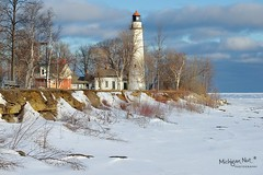 Pointe Aux Barques Lighthouse ~ Port Hope, Michigan. (Michigan Nut) Tags: sky lighthouse lake snow ice clouds sunrise landscape frozen midwest michigan scenic landmark structure lakehuron johnmccormick pointauxbarqueslighthouse michigannutphotography