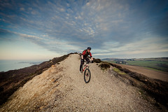 It's all downhill from here... (s0ulsurfing) Tags: england sky panorama cloud english texture nature weather sport clouds composition canon landscape island march spring scenery skies cyclist natural action britain path patterns wide mountainbike wideangle adventure cycle biking mtb isleofwight british isle nube wight meteorology thegreatoutdoors nephology gorse 6d sigma1224 2013 s0ulsurfing